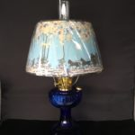 New Aladdin Lincoln Drape Table Lamp – Cobalt Blue glass base with Winter Parchment Shade.
